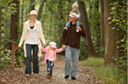 Photo of family walking in the woods